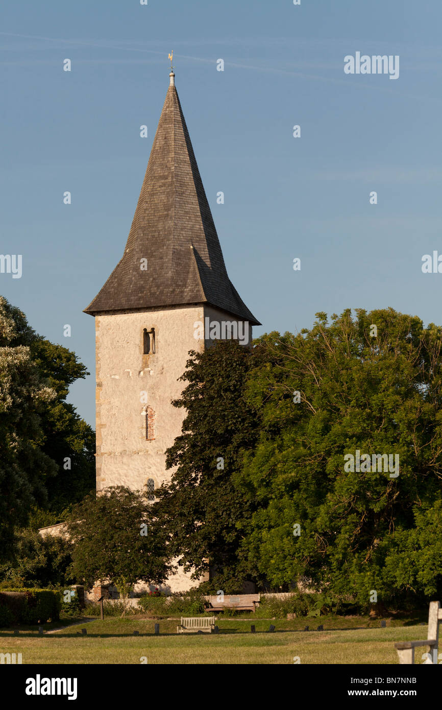Holy Trinity Church Bosham with its shingle covered spire on a sunny summer evening - Stock Image