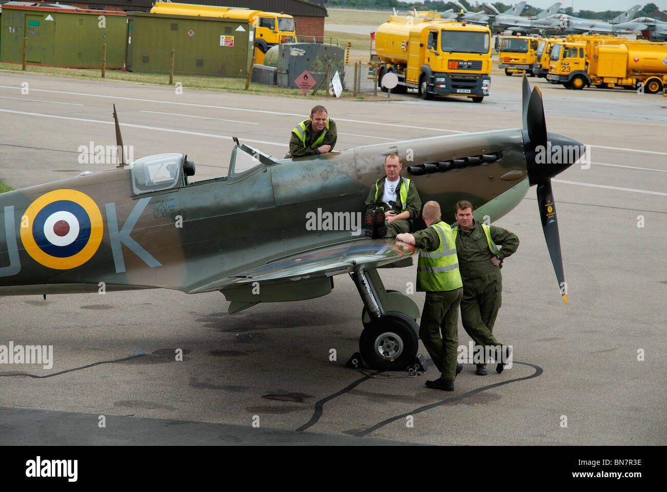 Spitfire and ground crew at Battle of Britain Memorial Flight, Coningsby, UK. - Stock Image