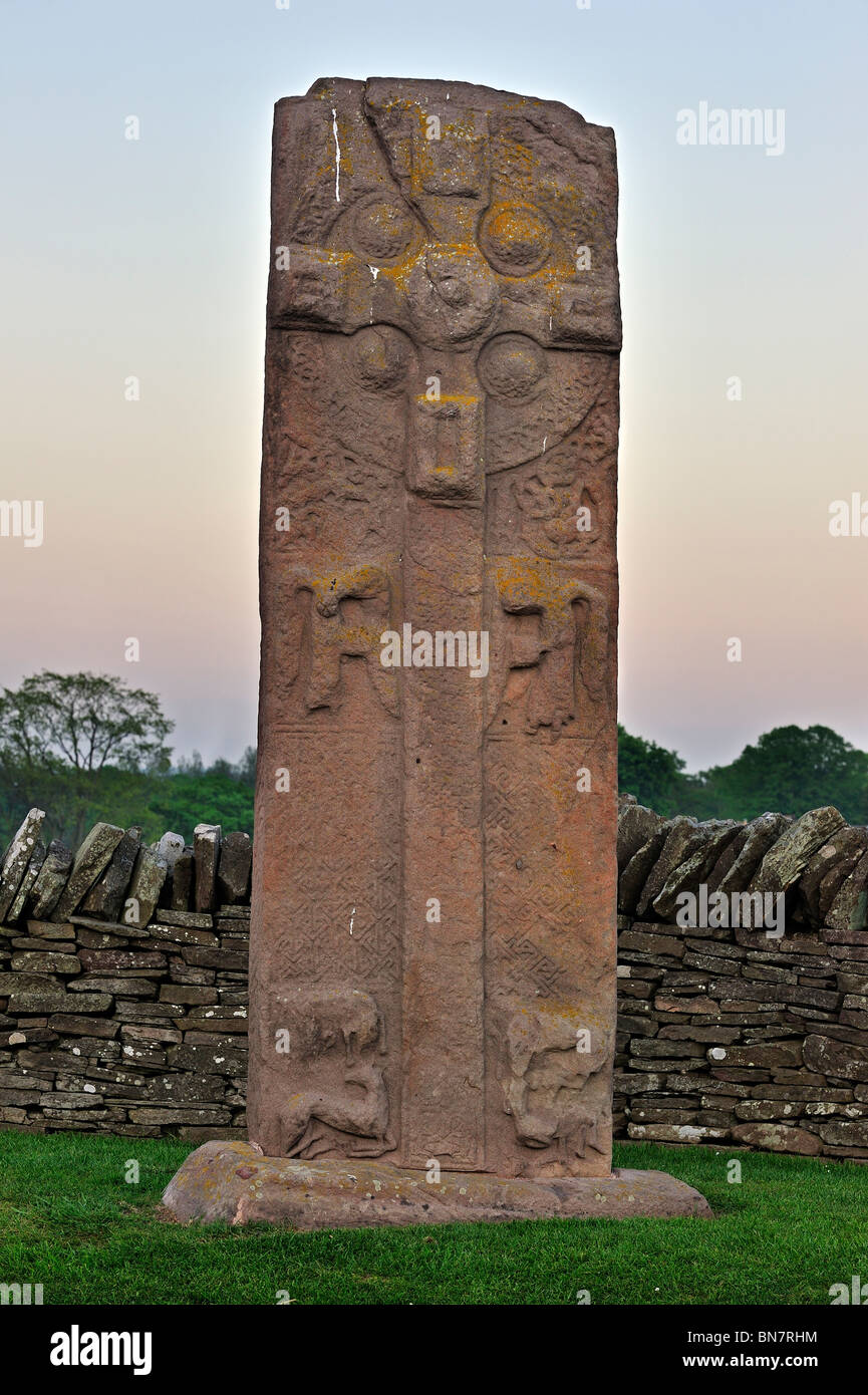 The Great Stone, a carved Pictish stone showing a Celtic Cross at Aberlemno at sunset, Scotland, UK Stock Photo