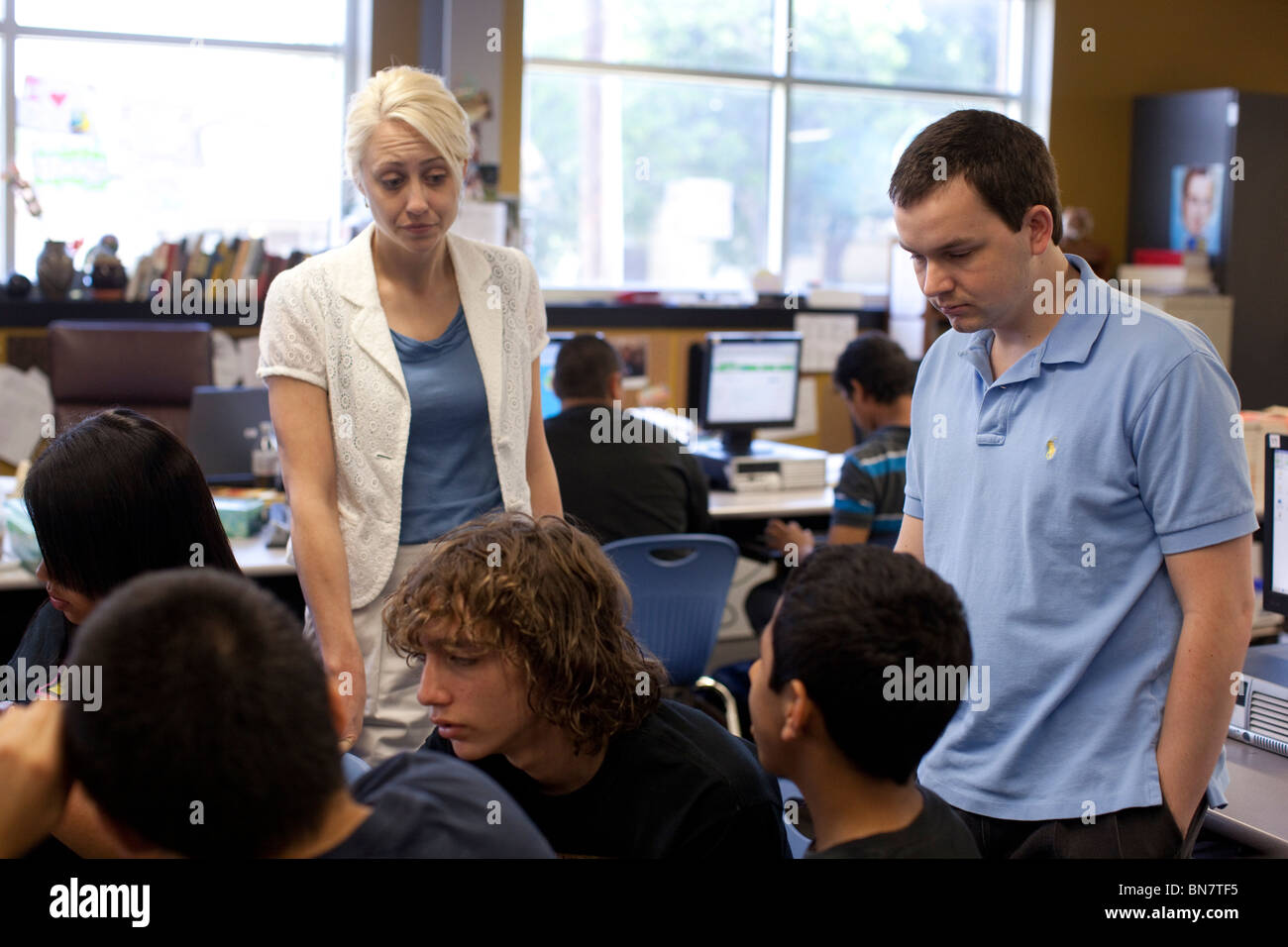 Anglo female and Angle male high school English teachers team-teach in large classroom Stock Photo