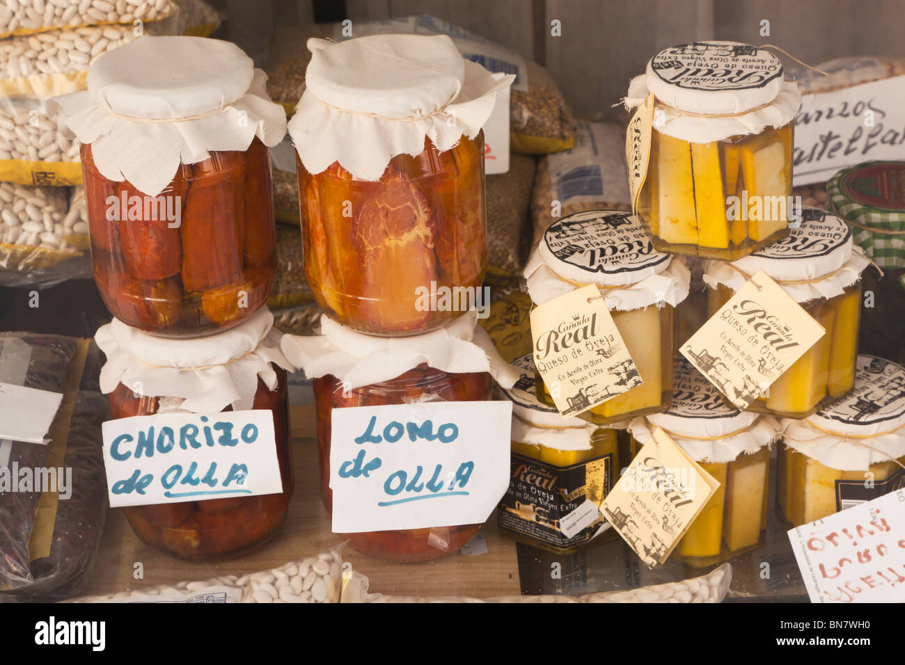 Avila, Avila Province, Spain. Bottles of preserved meats and cheeses. - Stock Image