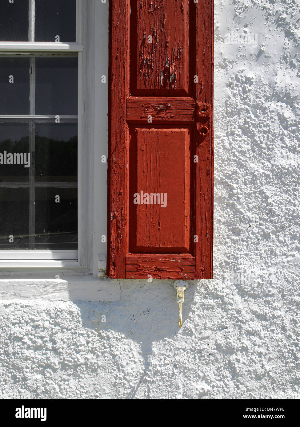Red Shutter,  Window & White Stucco Wall, Pennsylvania USA - Stock Image
