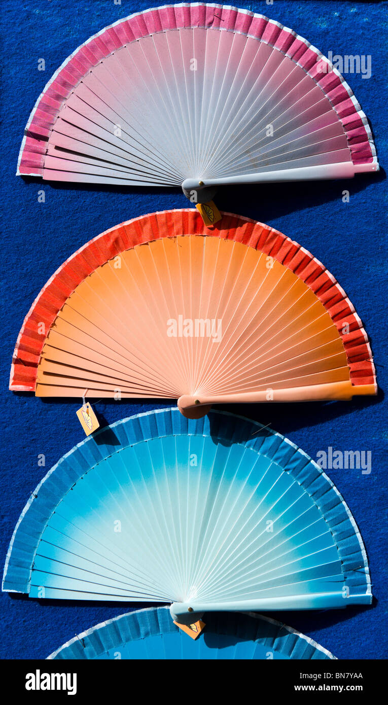 Hand-held folding fans in a shop on the Corso Vittorio Emanuele, Noto, southern Sicily, Italy - Stock Image