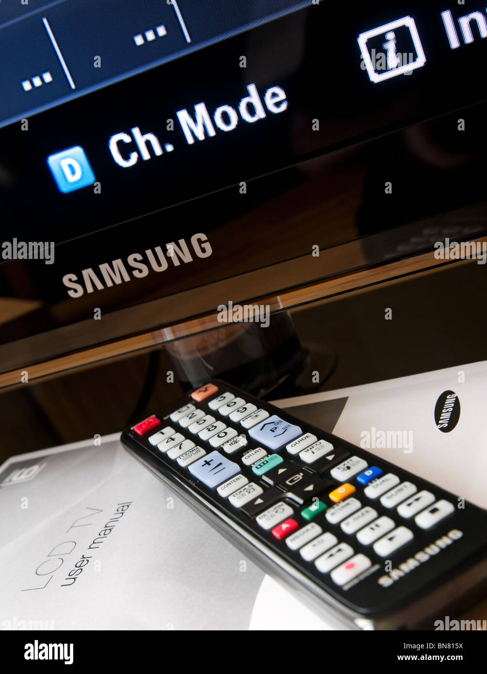 Samsung LCD flat screen television with remote control and the user manual. - Stock Image