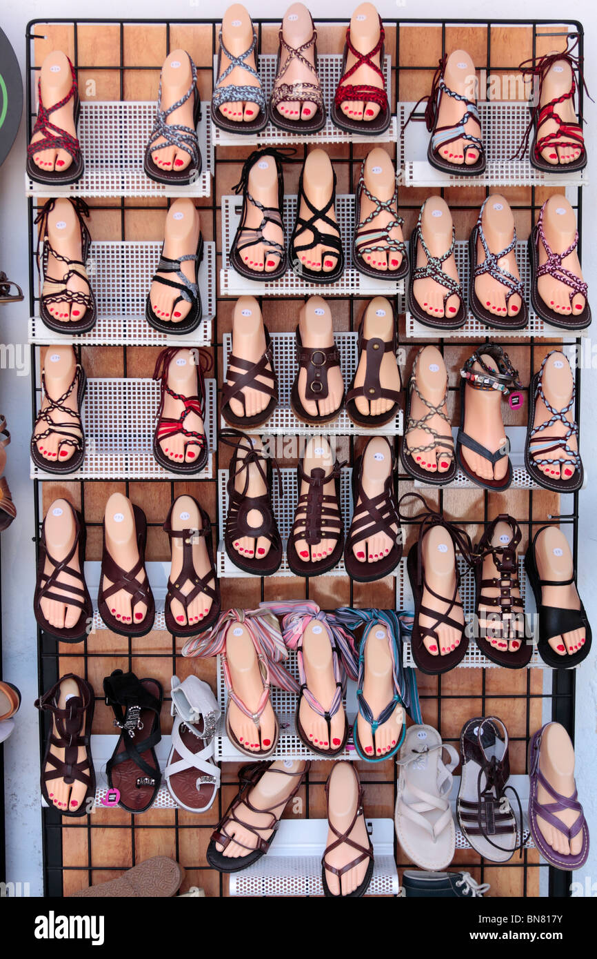 Sandals displayed on plastic feet outside a shoe shop in the Plaza Corredera Cordoba Andalucia Spain Europe - Stock Image