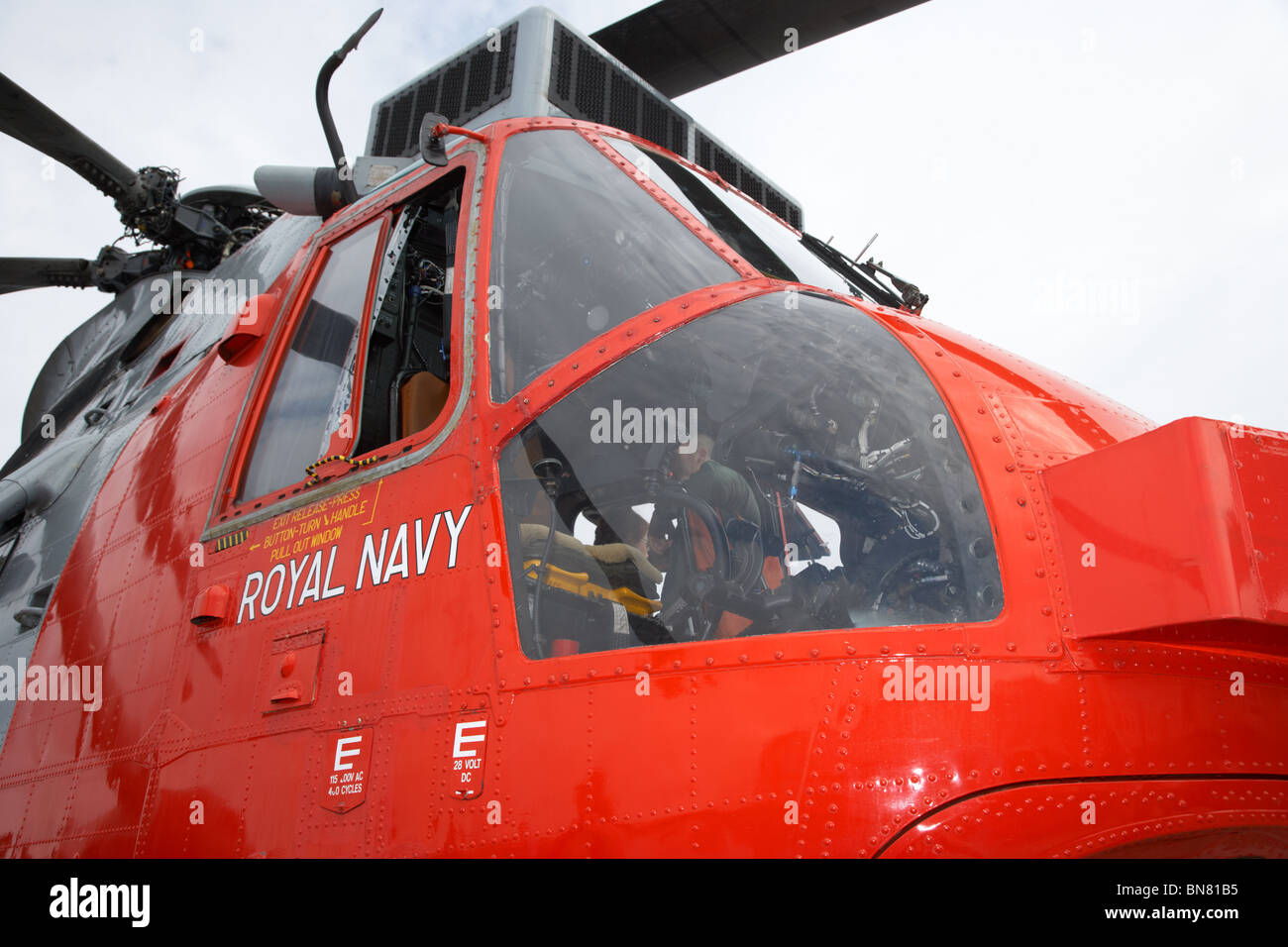 window and cockpit of a Royal Navy Rescue Westland Sea King HU5 helicopter XZ920 visiting Bangor Northern Ireland - Stock Image