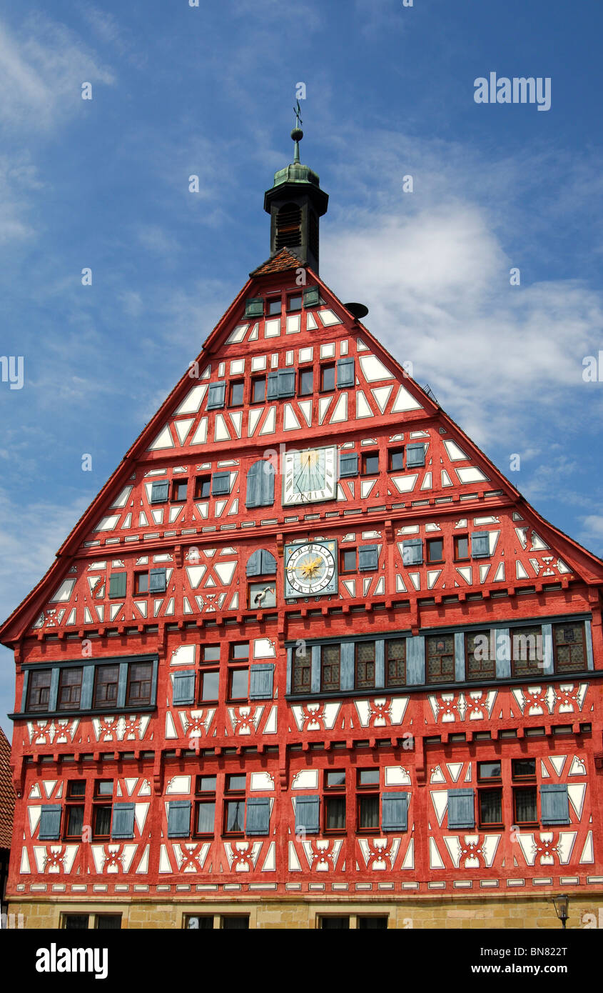 Half-timbered town hall with clock, sun dial and stork as heraldic animal, Grossbottwar, Baden-Wuerttemberg, Germany - Stock Image