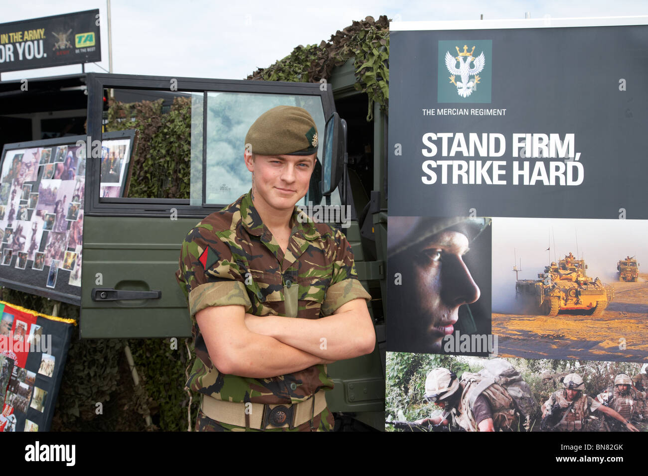 British Army soldier from the Mercian Regiment on an outdoor army recruitment stand at an event in the uk - Stock Image