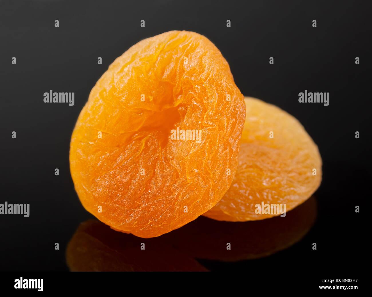 Yellow dried fruit apricot closeup on black - Stock Image