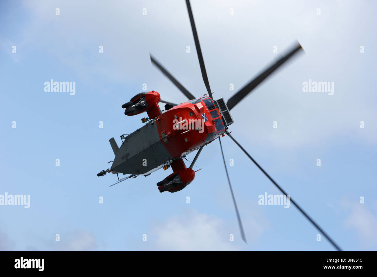 Royal Navy Rescue Westland Sea King HU5 helicopter XZ920 flying in the UK - Stock Image