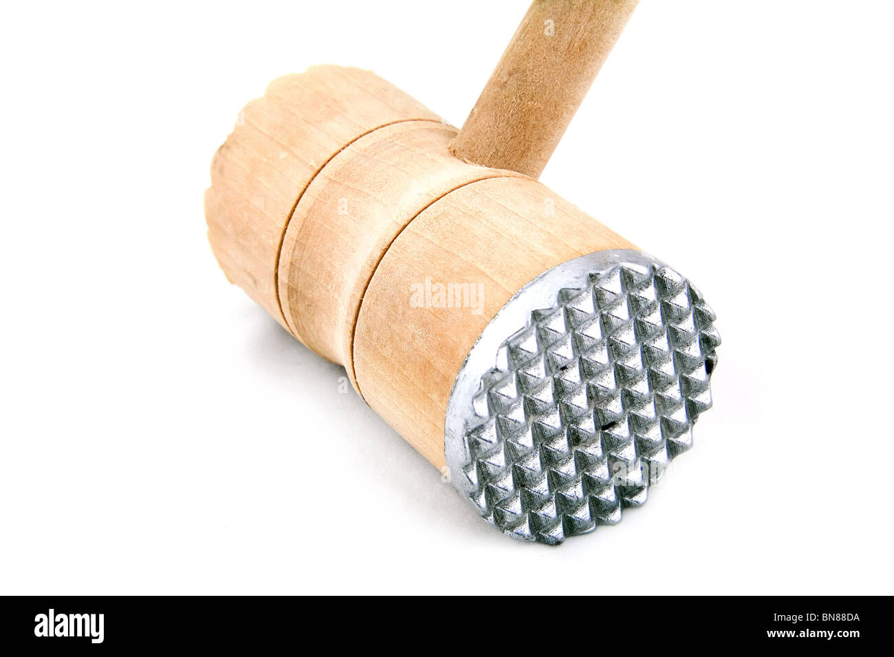 Meat tenderizer. Wooden meat hammer on white background. Stock Photo