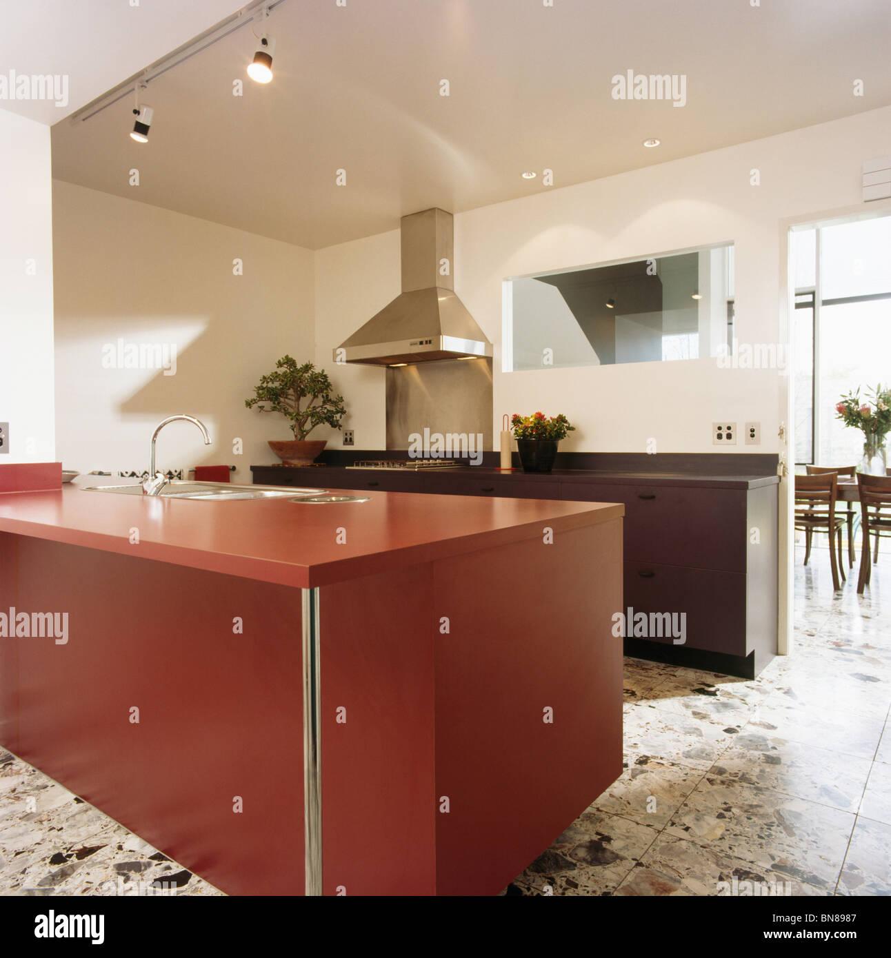 Red Fitted Unit In Large Modern White Kitchen With Terrazzo