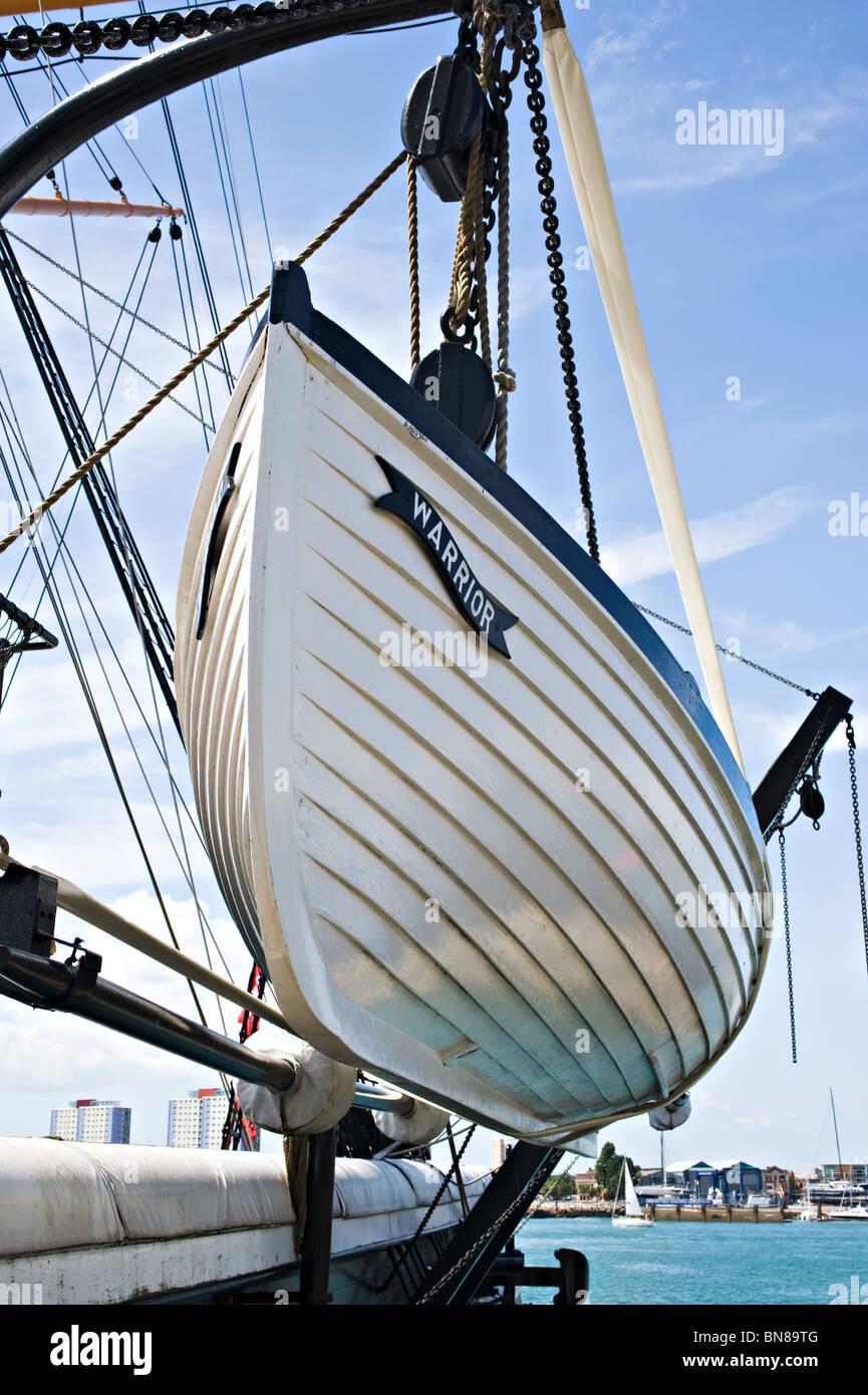 Longboat on Davits Belonging to HMS Warrior at Portsmouth Naval Dockyard Museum Hampshire England United Kingdom - Stock Image