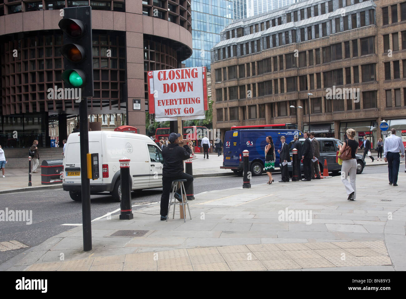Man holding closing down placard in the City of London GB UK - Stock Image