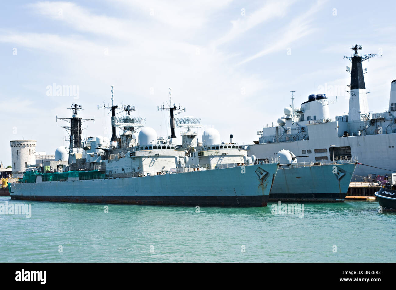 Two Royal Navy Type 42 Destroyers Laid Up at Portsmouth Naval Dockyard with HMS Invincible R05 England United Kingdom - Stock Image