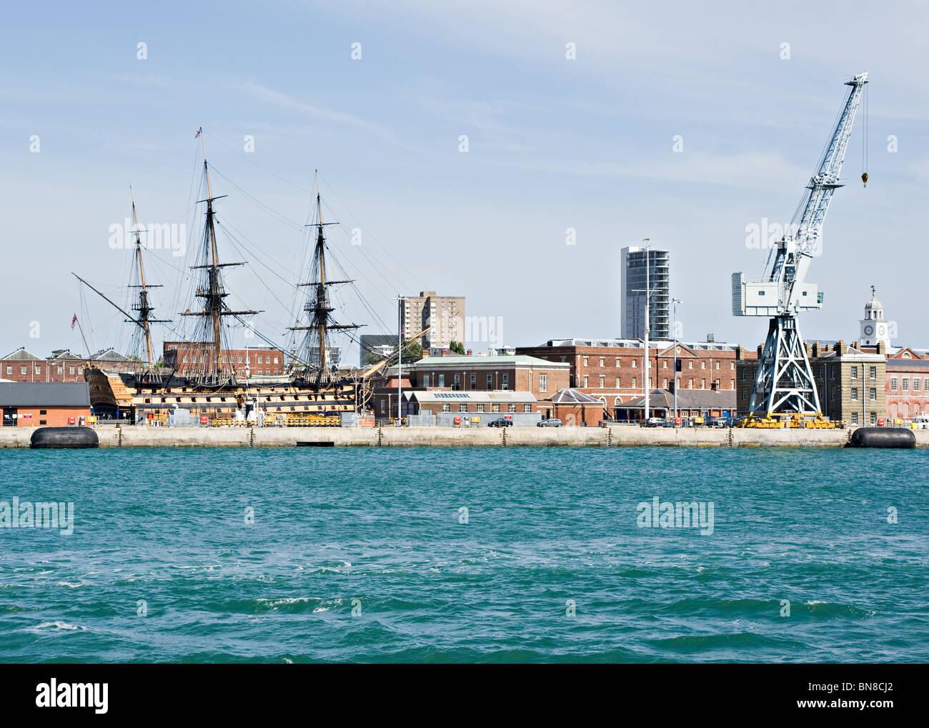 British Royal Navy Historic Warship HMS Victory at Portsmouth Naval Dockyard With Dockside Crane England United Stock Photo