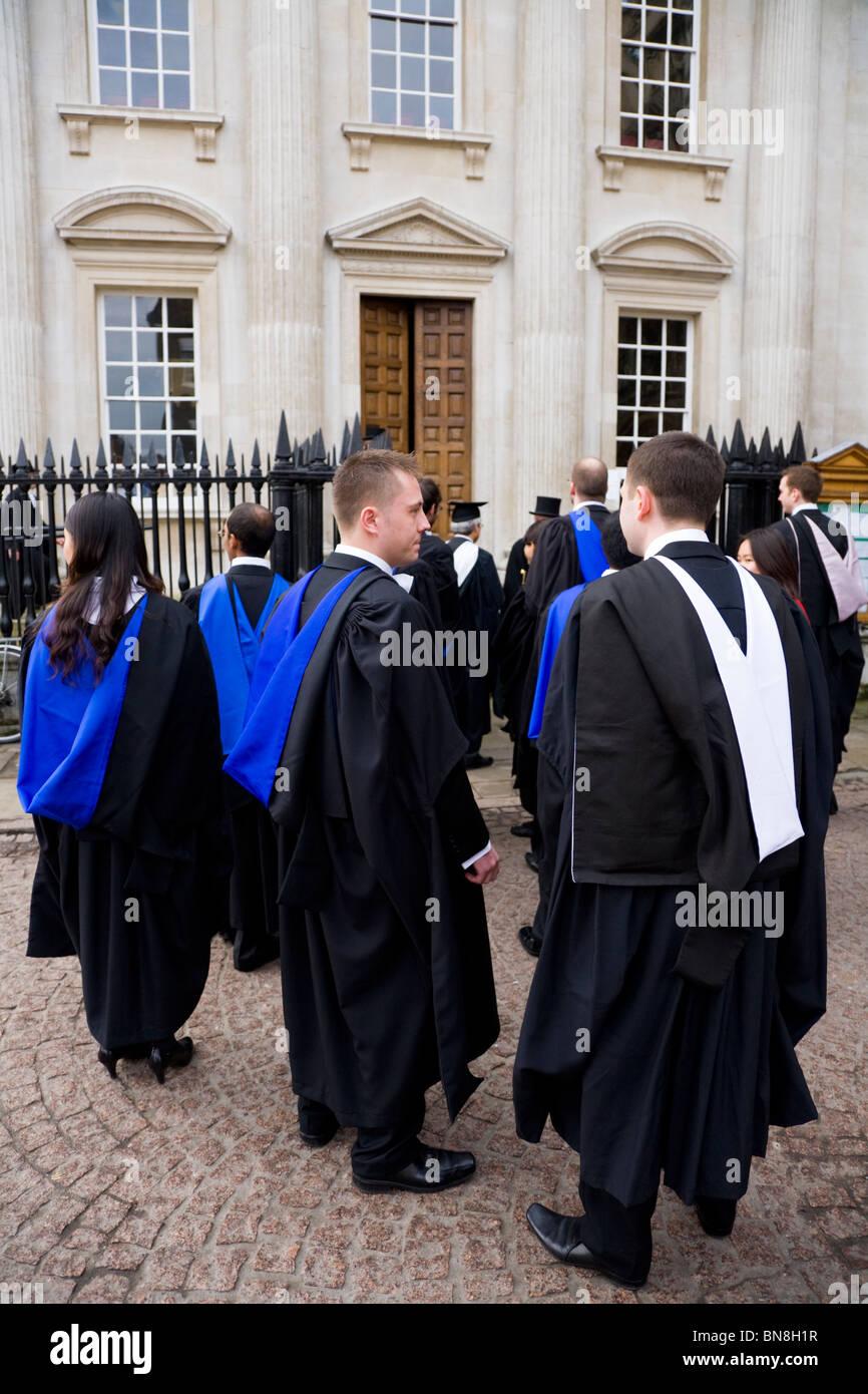 Graduates In Graduation Gowns Robes At A Graduate Graduating Stock Photo Alamy
