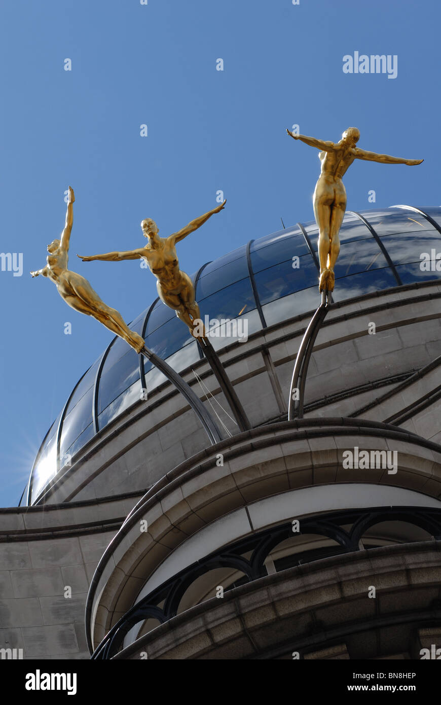 The 'Three synchronized divers' statue on top of the Criterion Building. - Stock Image