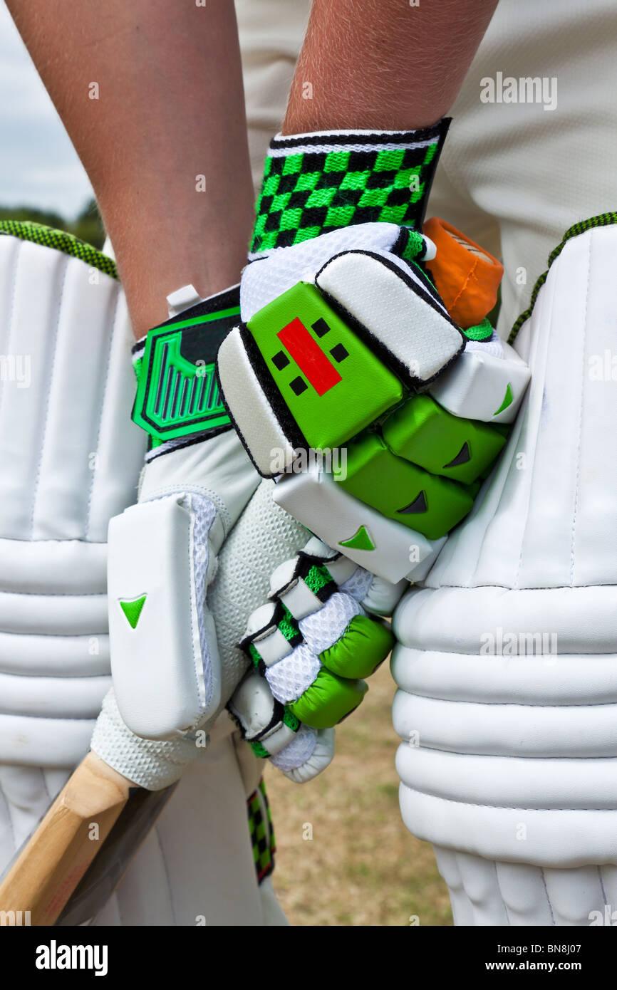 Cricket batsman stood at the crease holding the bat - Stock Image