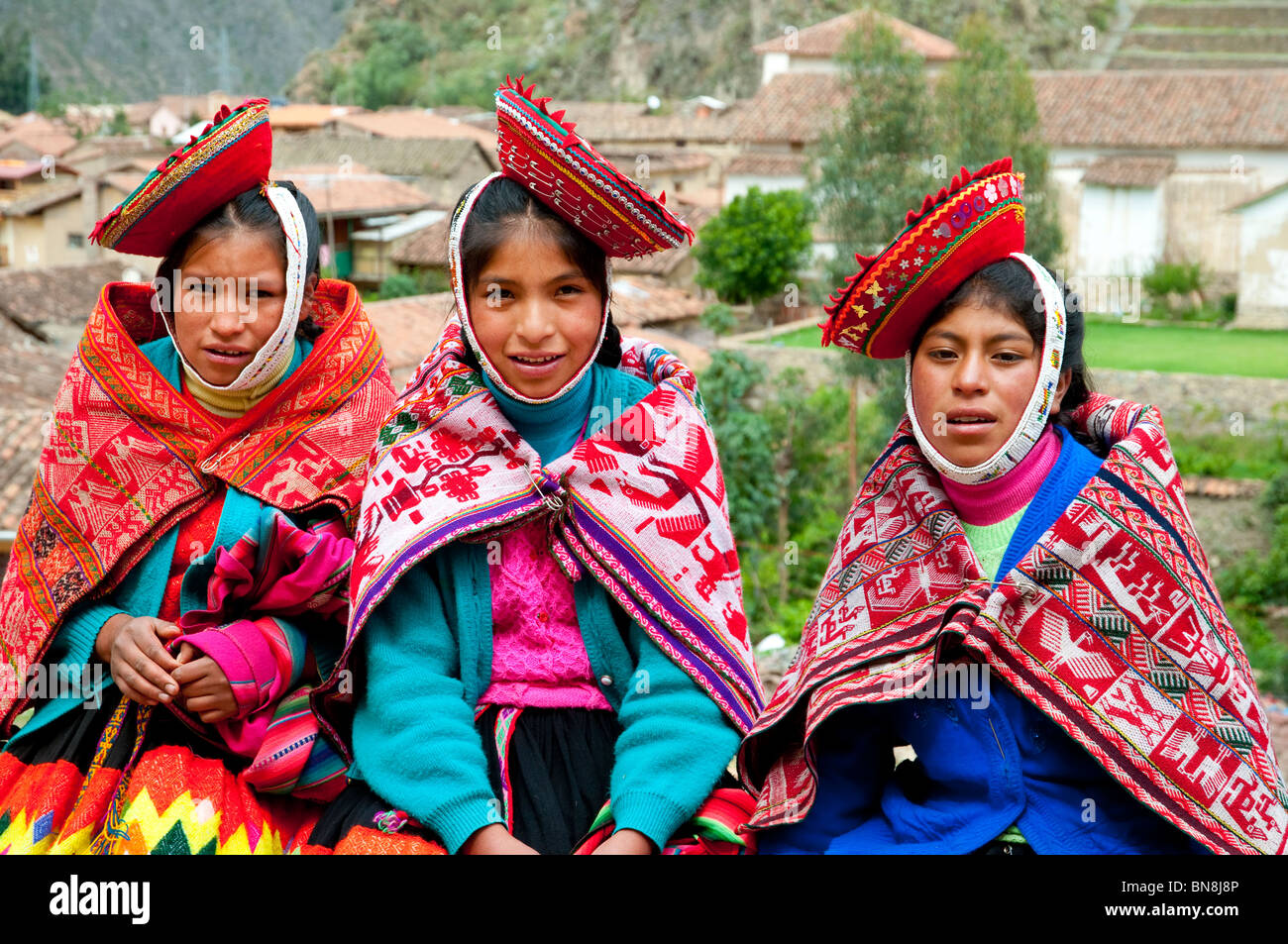 Peruvian Girls In Traditional Dress In Ollantaytambo