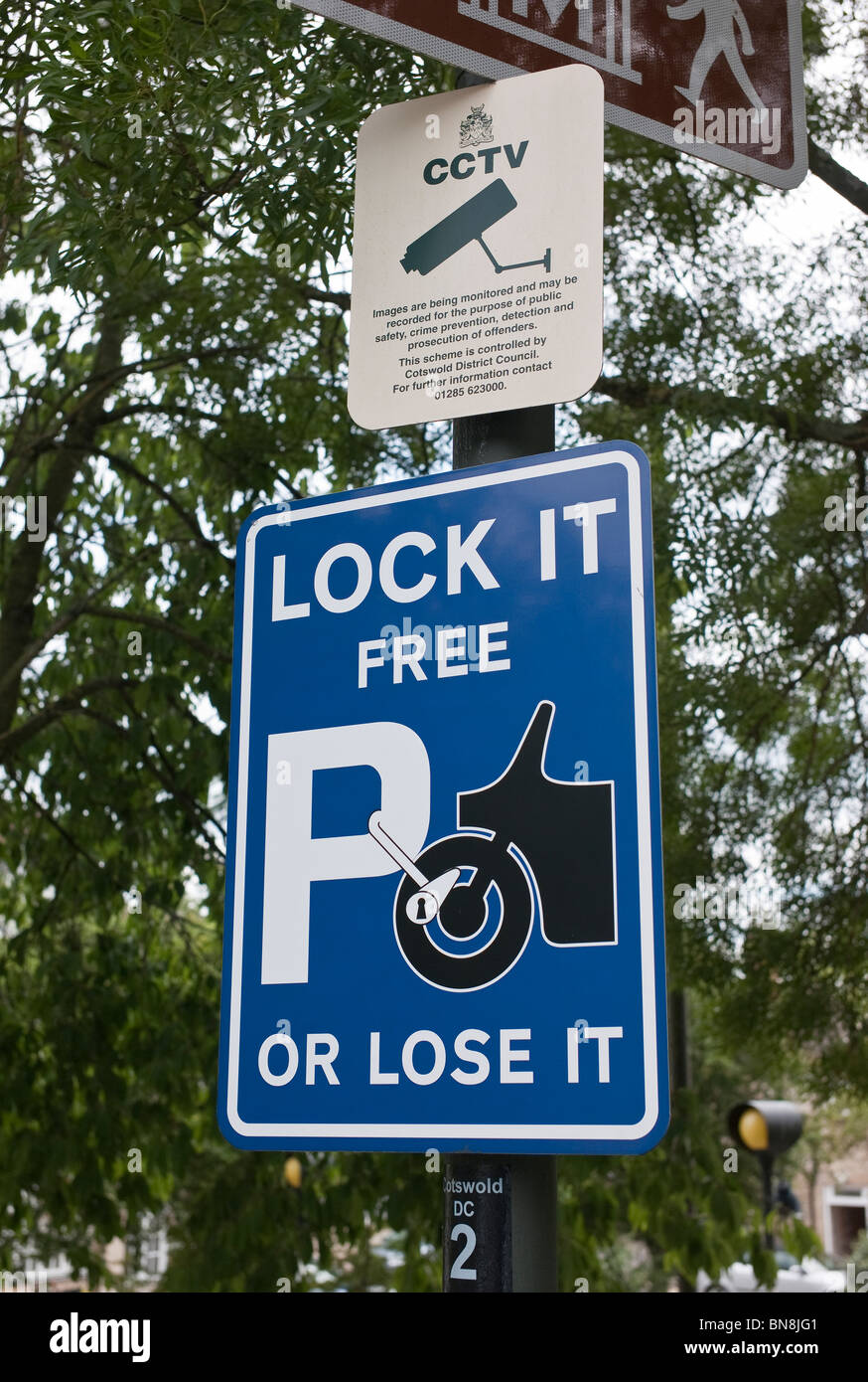 Sign in car park warning motor cyclists to lock their property or risk theft - Stock Image