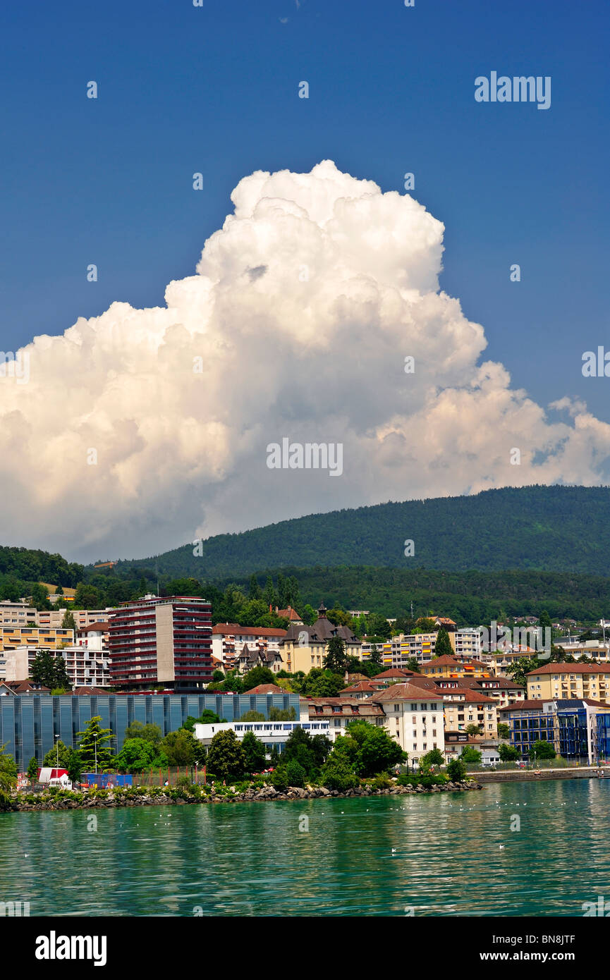 Cumulus castellanus cloud rising over the Jura mountains at Neuchatel in summer - Stock Image