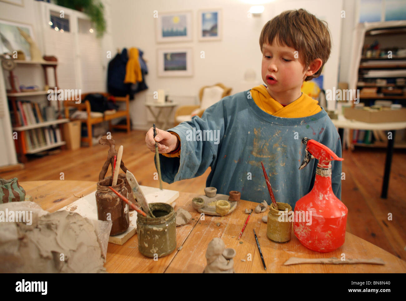 Boy making pottery - Stock Image