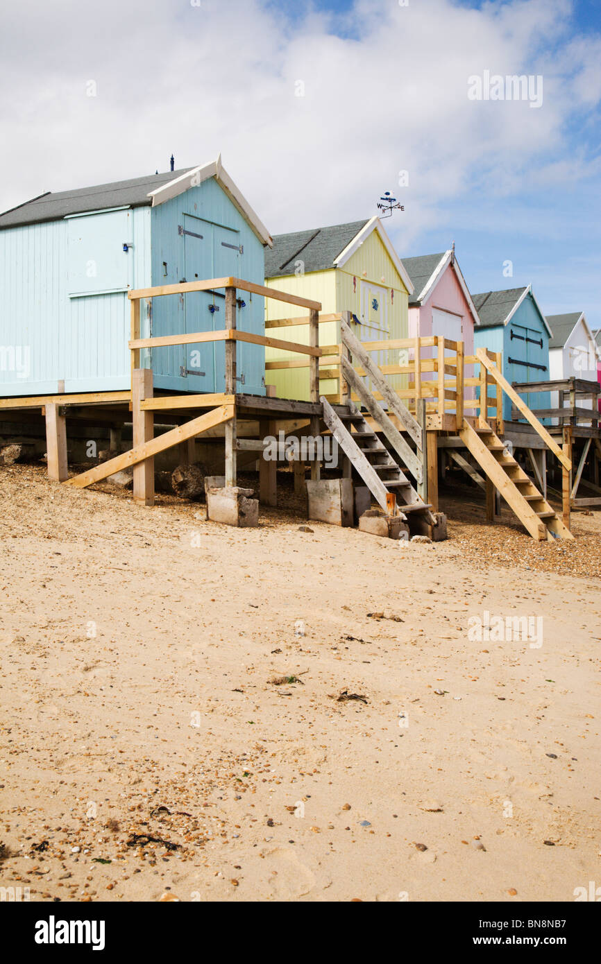 Traditional beach huts overlooking Felixstowe beach, Suffolk, England. - Stock Image