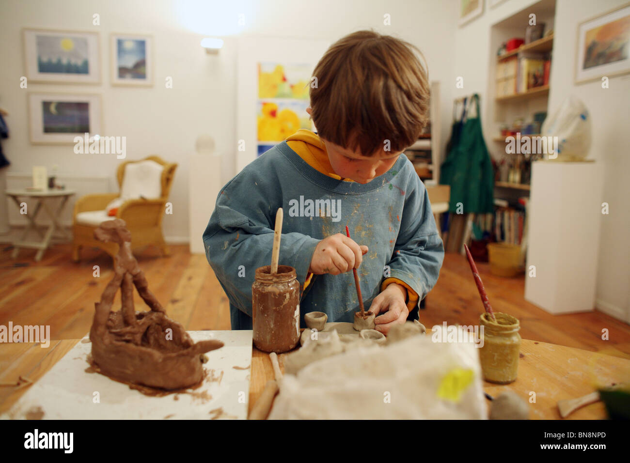 Boy making pottery - Stock Image