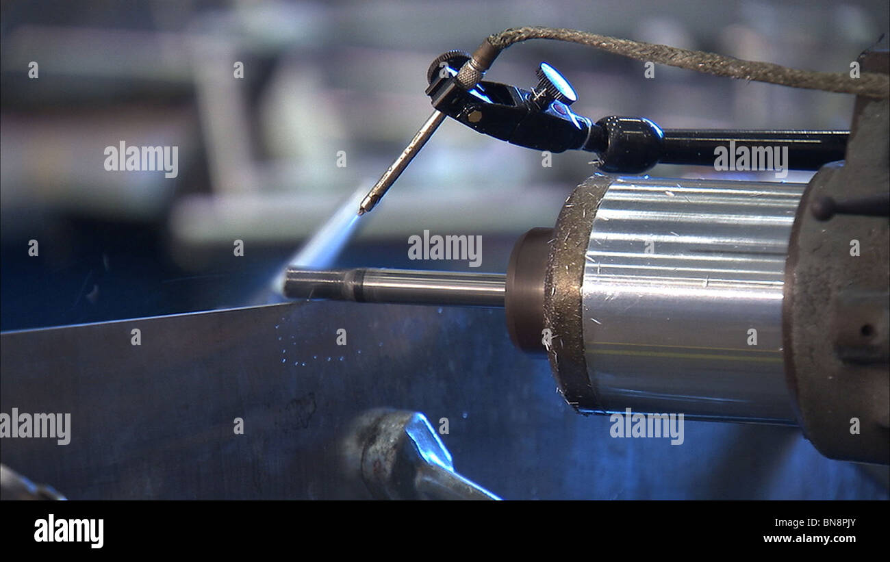 Preparations and placement of confidence ring on friction stir weld. - Stock Image