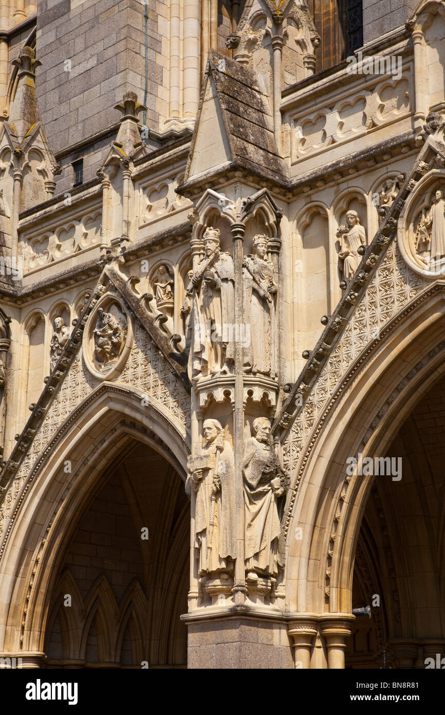 Truro cathedral front facade, stone carved figures, Cornwall, UK - Stock Image