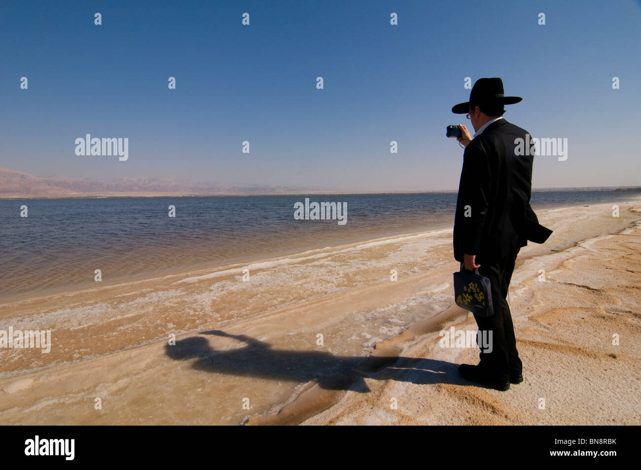An Ultra orthodox  religious Jew at  the shore of the Dead Sea. Israel - Stock Image