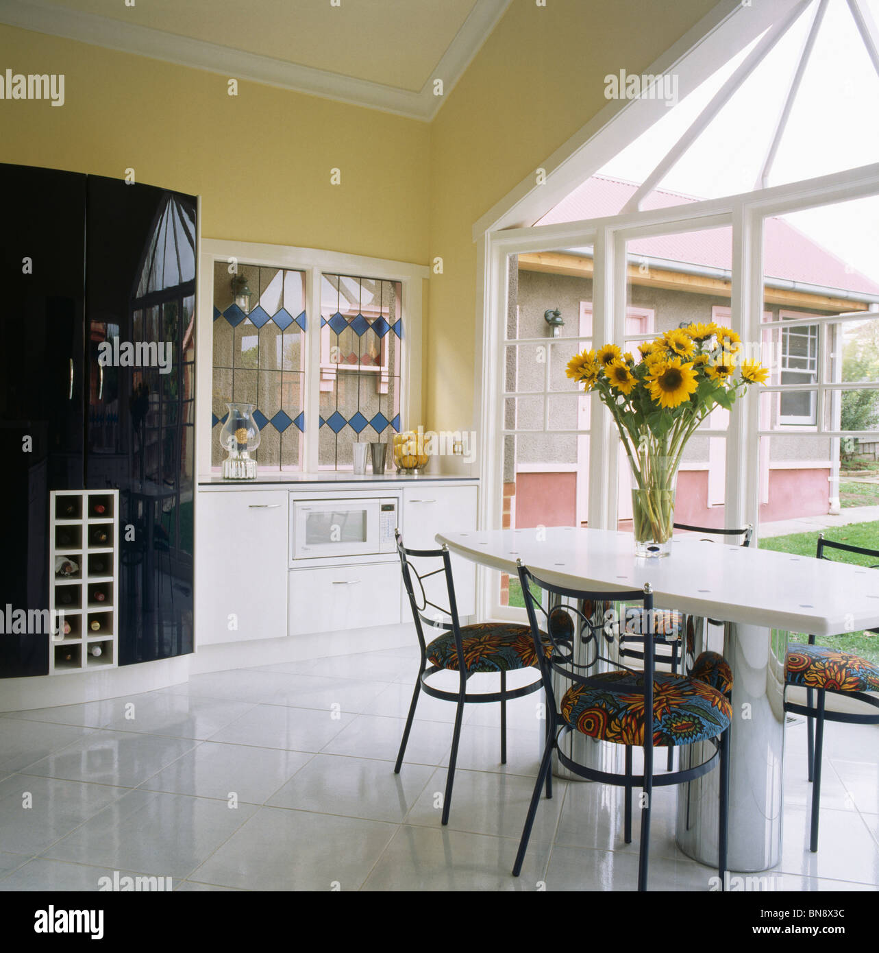 Kitchen Interior With Pink Furniture And Tiles Stock: White Ceramic Floor Tiles In Modern Pale Yellow Kitchen