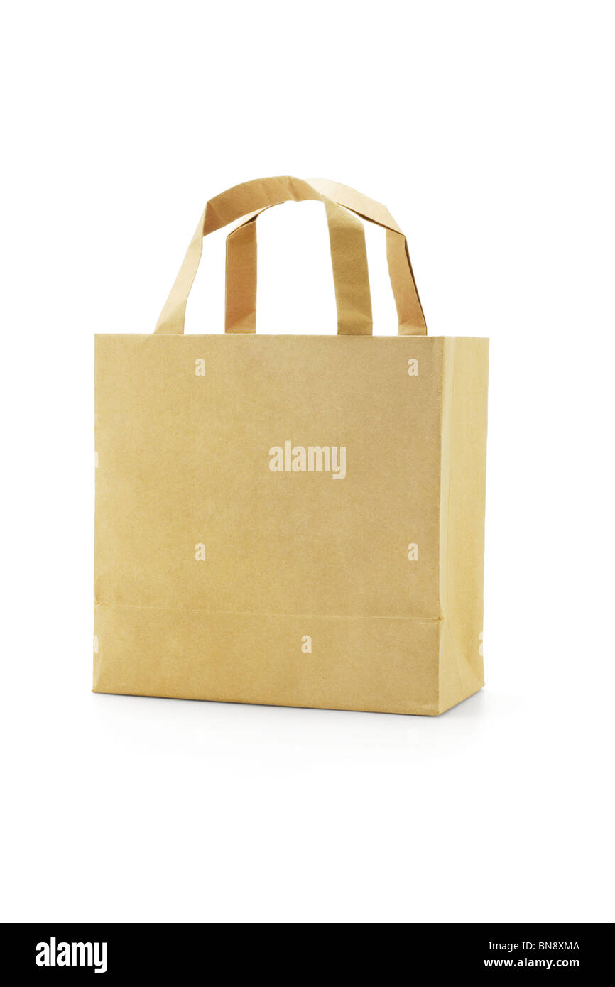 Brown reusable paper bag on white background - Stock Image
