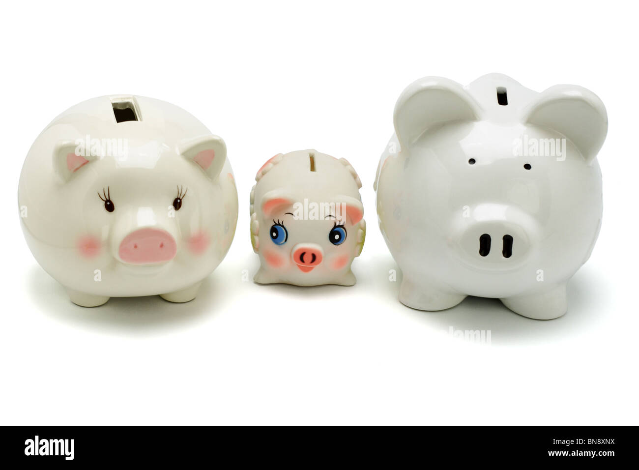 Family of piggy banks on white background - Stock Image