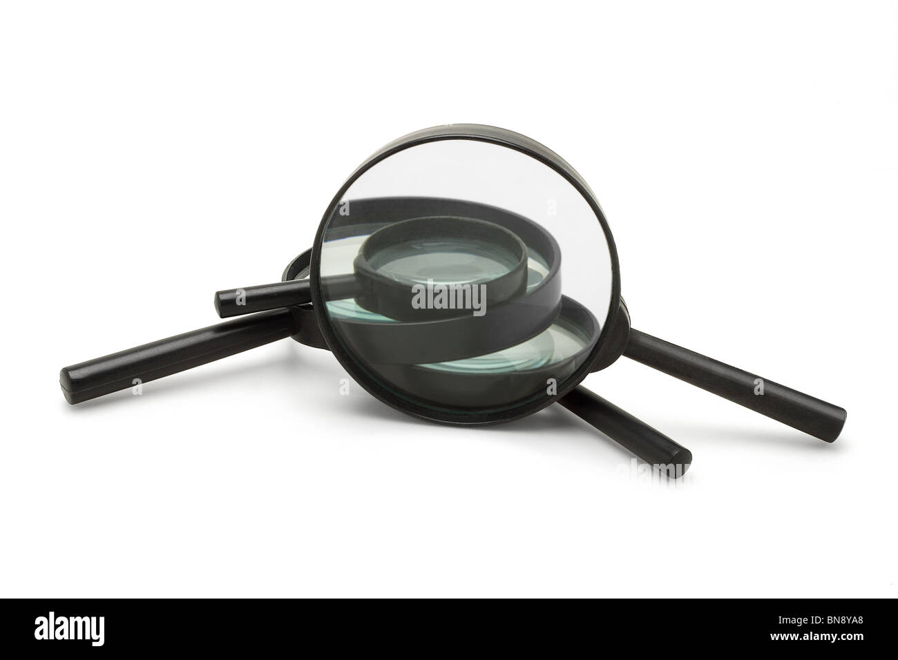Magnifying glasses of various sizes on white background - Stock Image