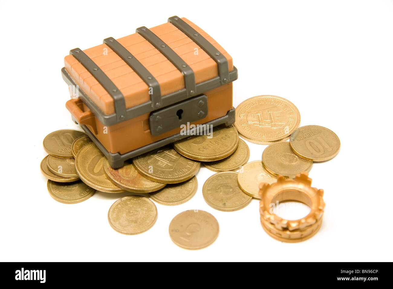 Open toy pirate chest whit argentinian money and King crown over white background - Stock Image