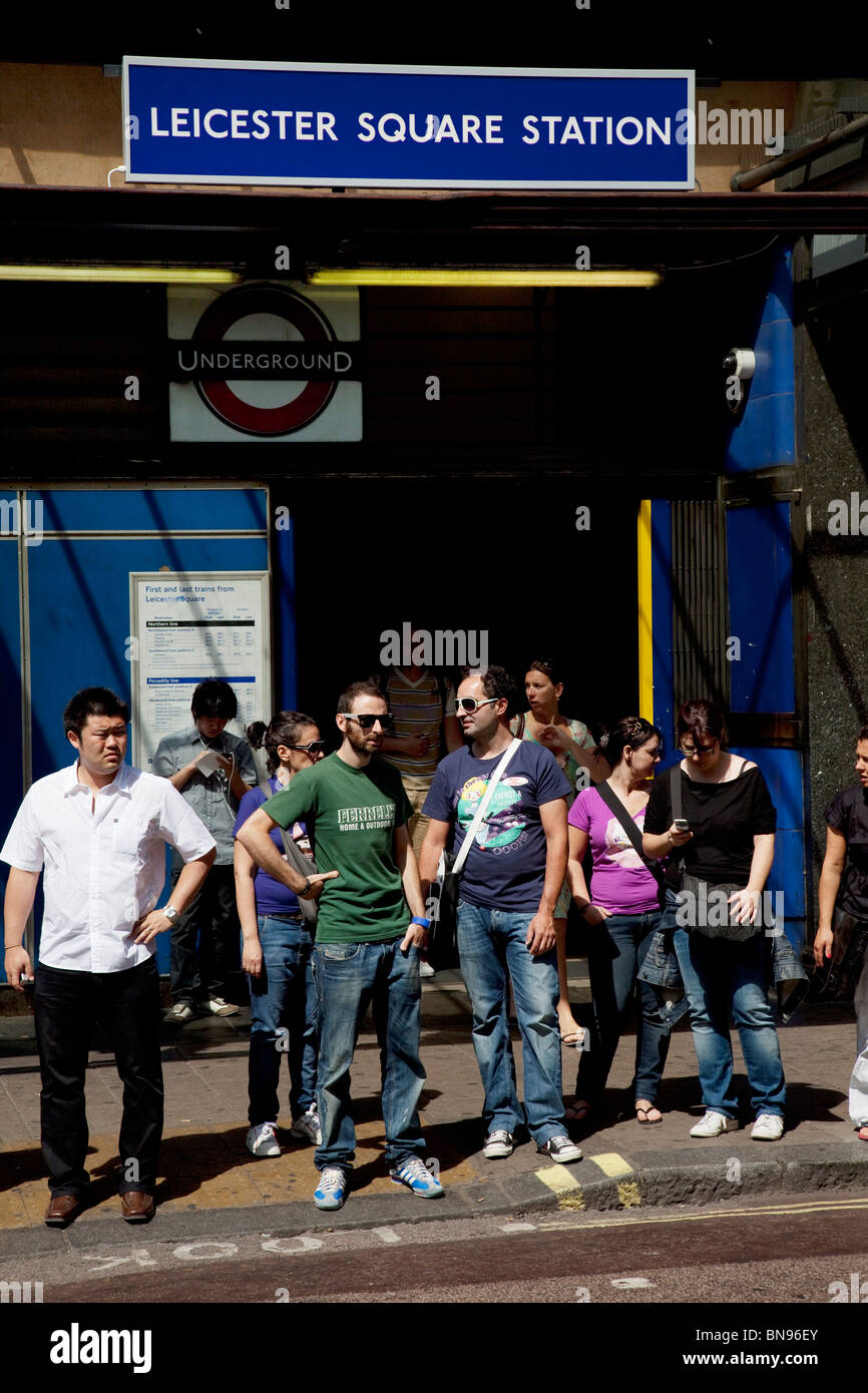 Leicester Square, a hugely popular area for tourism in the West End, London. Here the busy exit to the underground - Stock Image