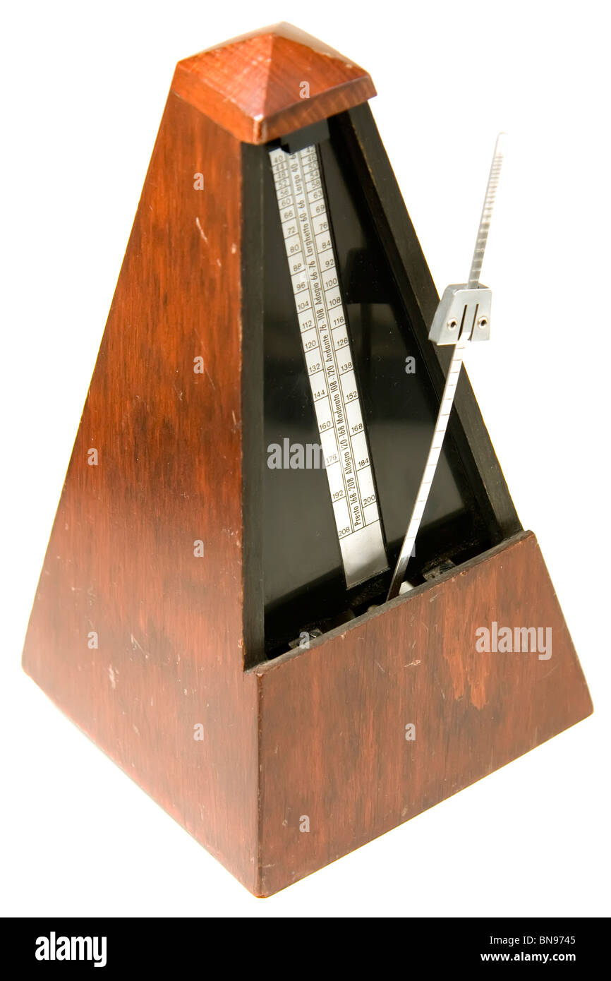 Isolated old metronome over white - Stock Image