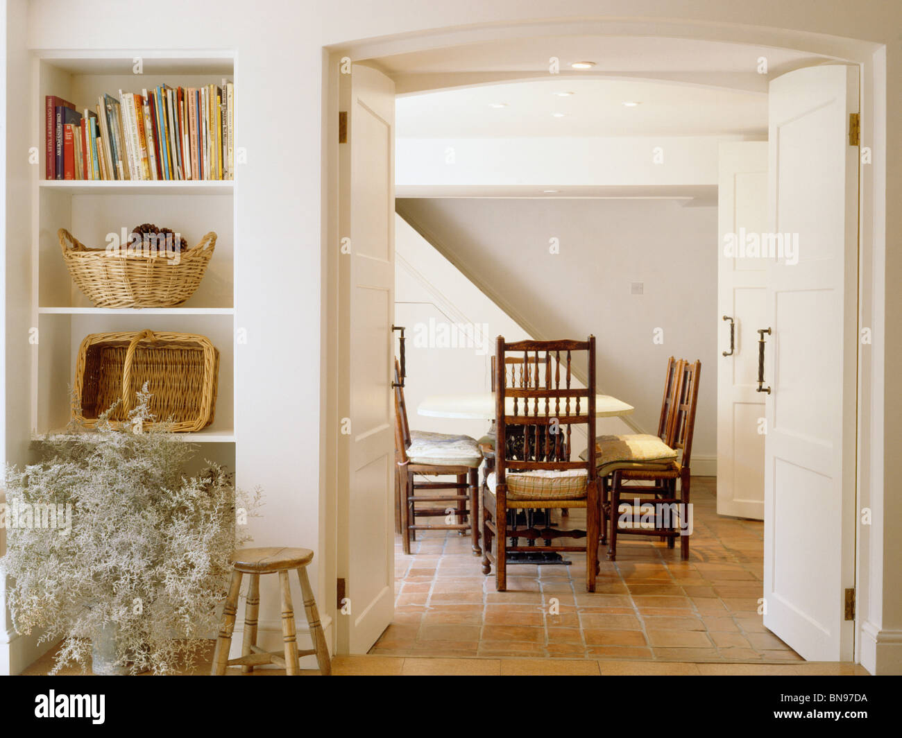 Alcove Shelves Beside Open Double Doors To Cream Country Dining Room