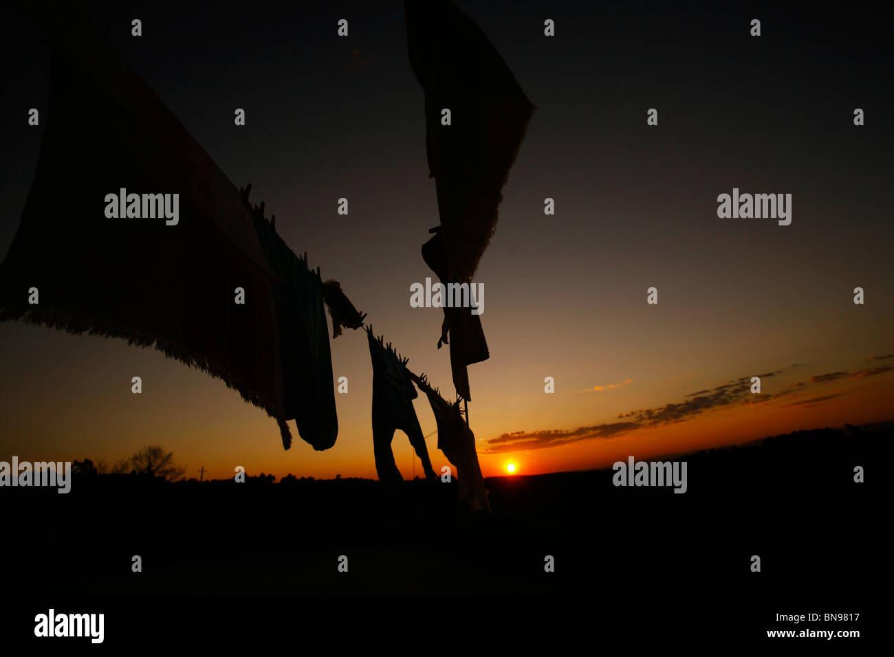 Drying linen. Sunset Stock Photo
