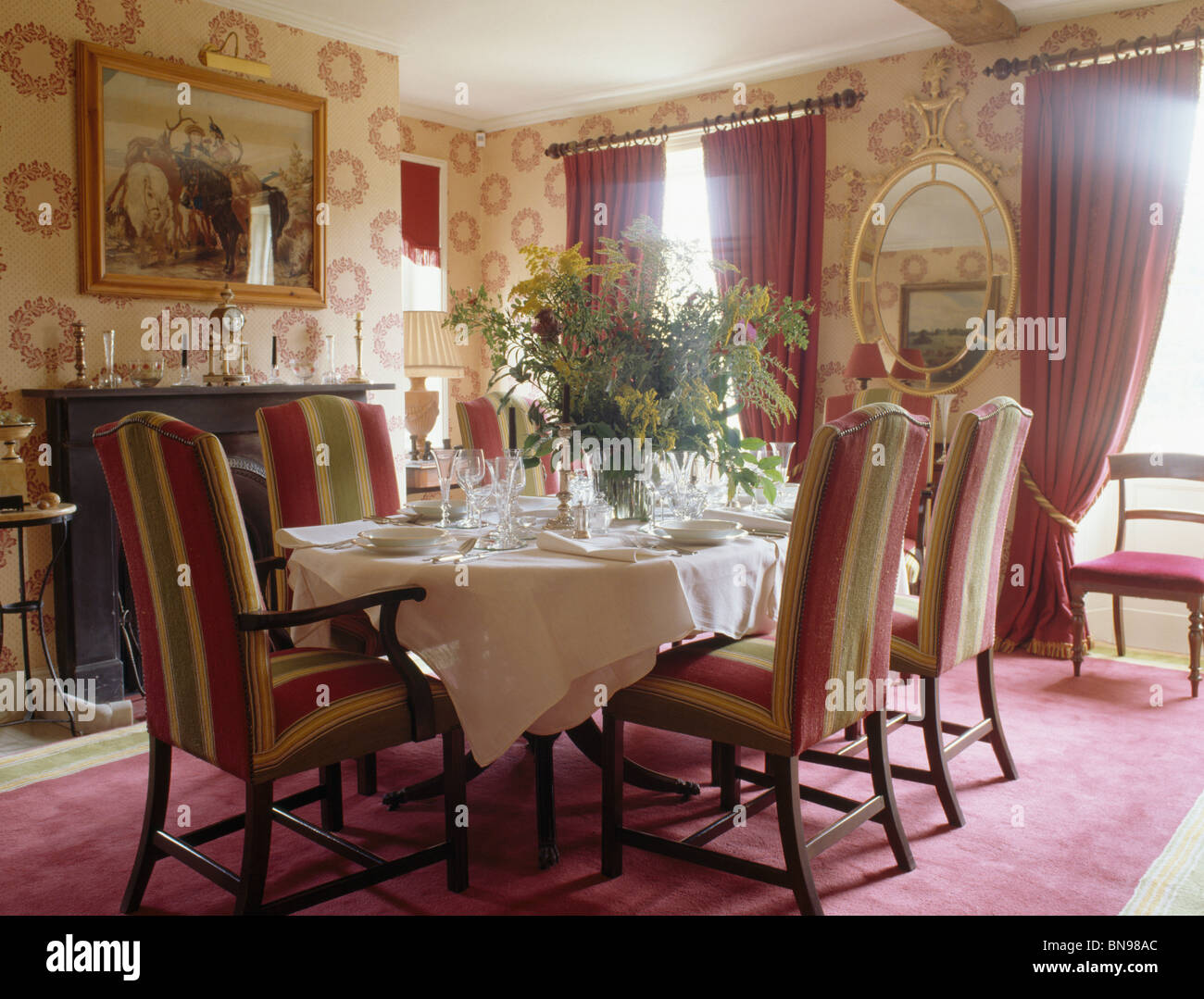 Patterned Wallpaper And Striped Upholstered Chairs In Traditional Country  Dining Room With Pink Curtains And Pink Carpet