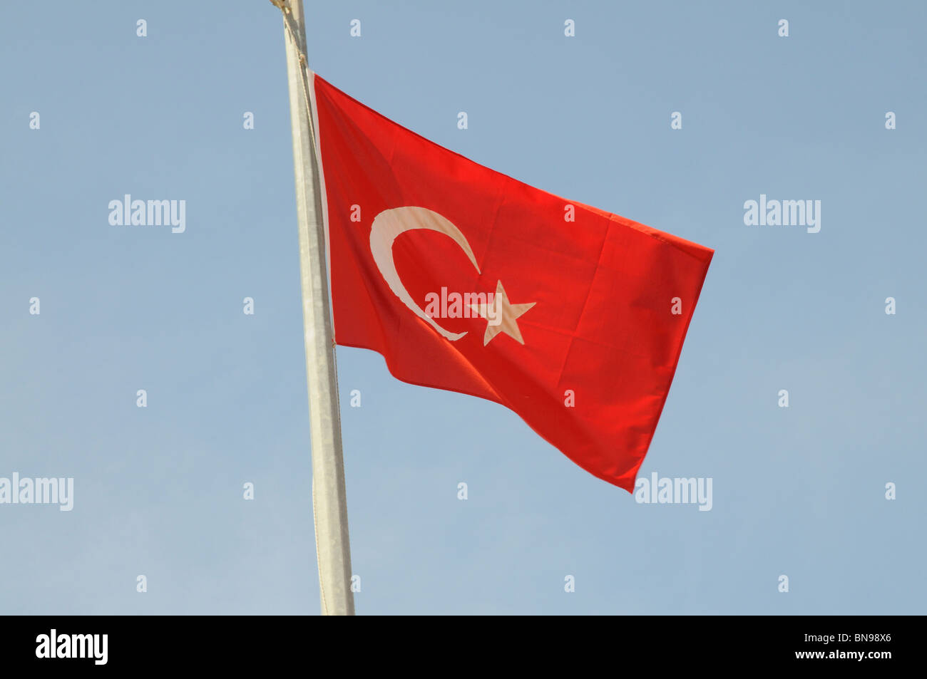 Turkish national flag blowing from a flagpole - Stock Image