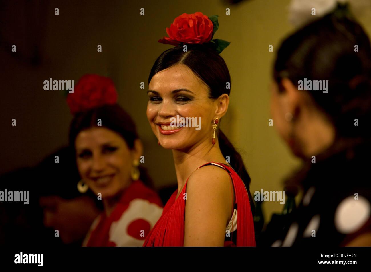 A Flamenco dancer, or bailaora, smiles during a performance in the Tablao Flamenco El Cardenal in Cordoba, Andalusia, - Stock Image