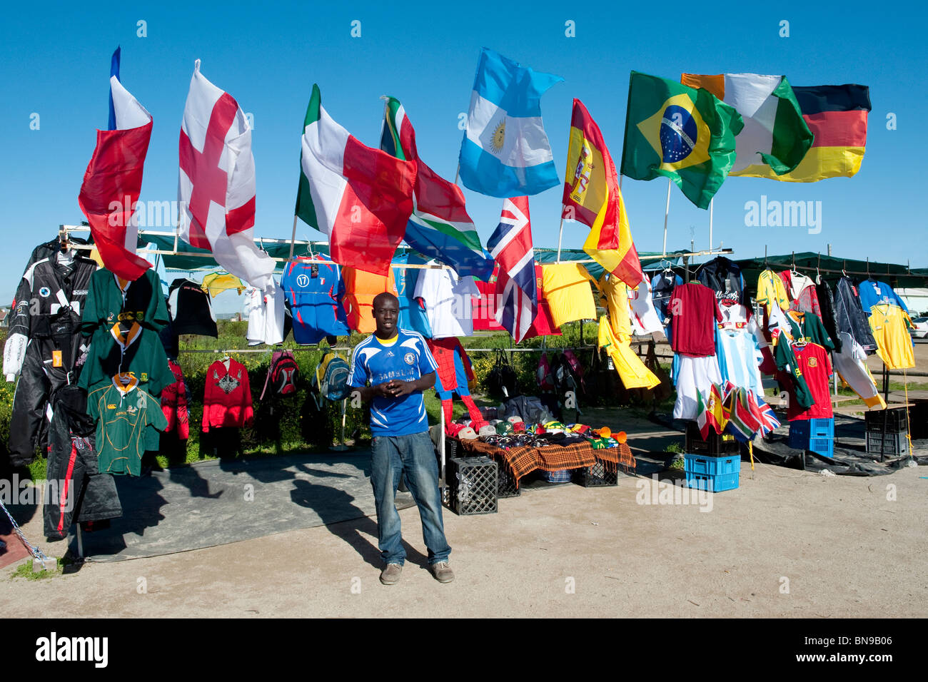 Vendor in front of his kiosk with Wold Cup 2010 Utensils in Langebaan Western Cape South Africa - Stock Image