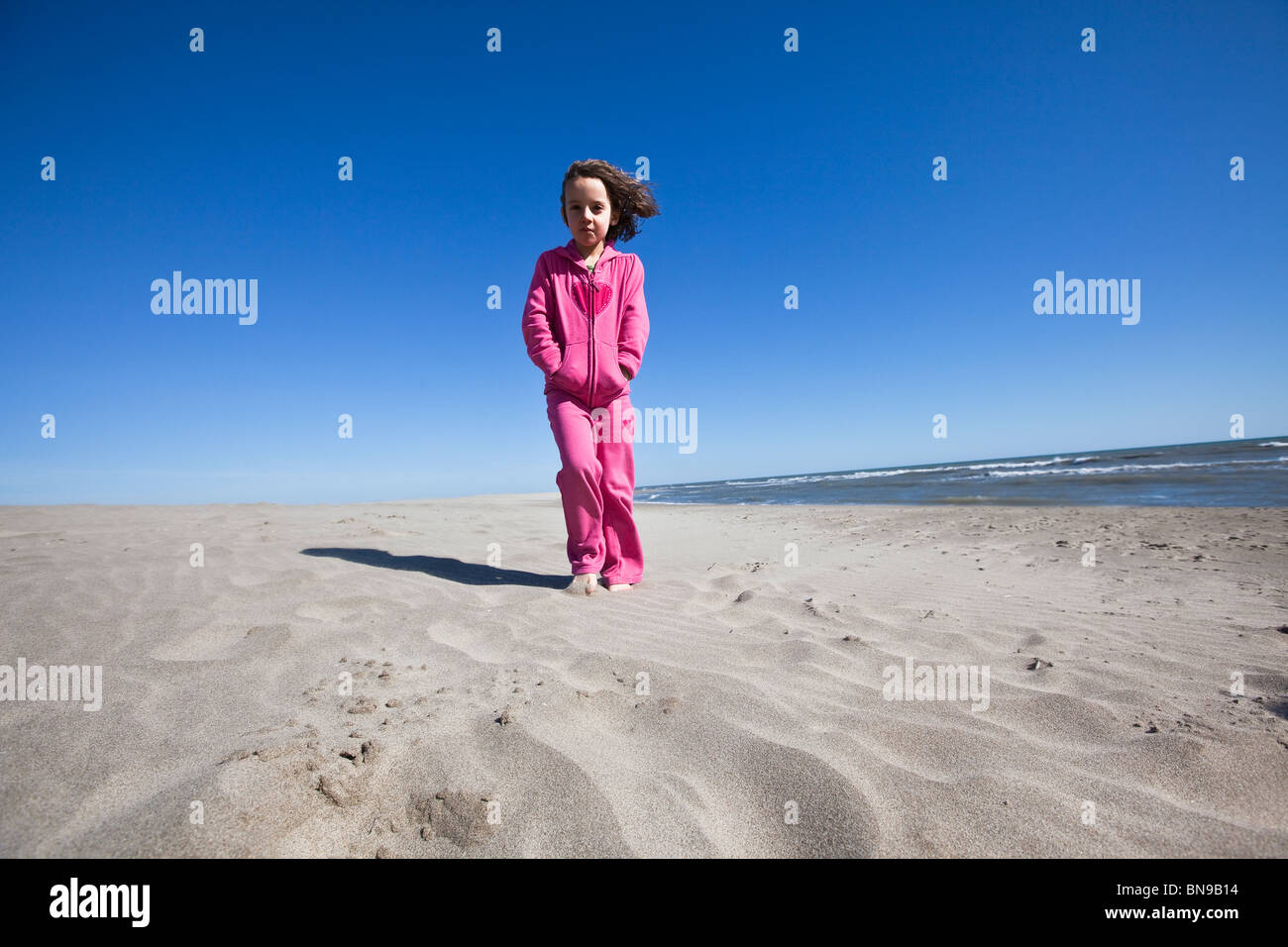 Girl walking on a beach in France. Stock Photo