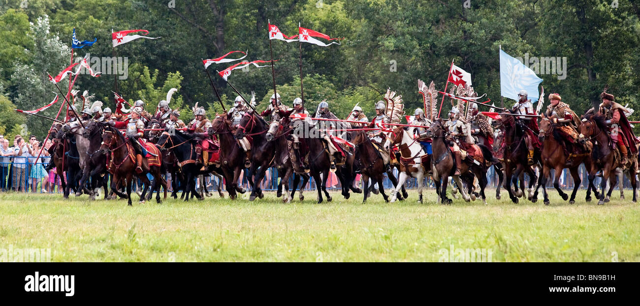 Polish hussar cavalry knights charge at Battle of Klushino - 400 years festival in Warsaw, Poland, 3-4 of July 2010. - Stock Image
