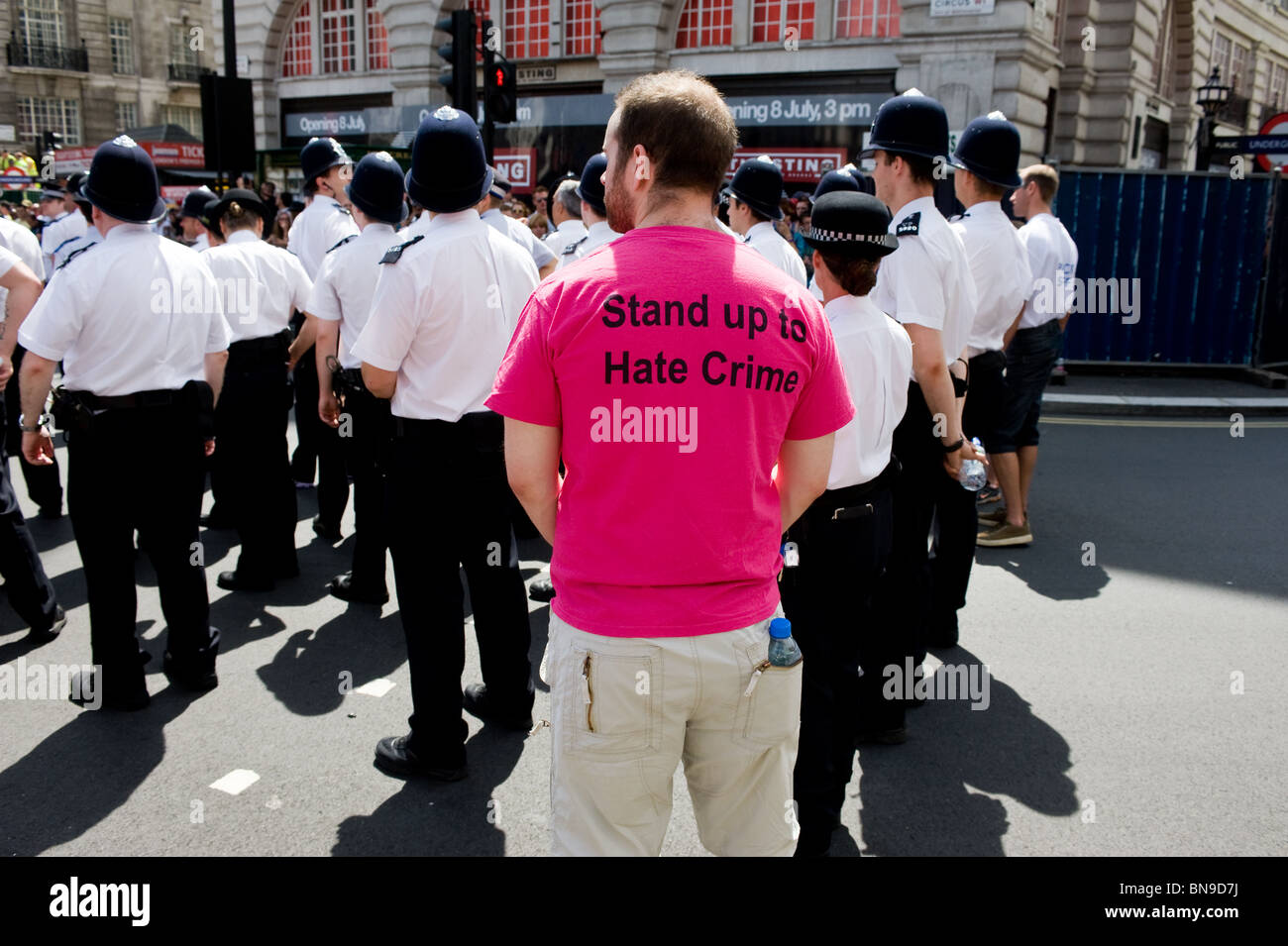 A participant wearing a 'stand up to hate crime' T shirt during the Pride London celebrations. - Stock Image