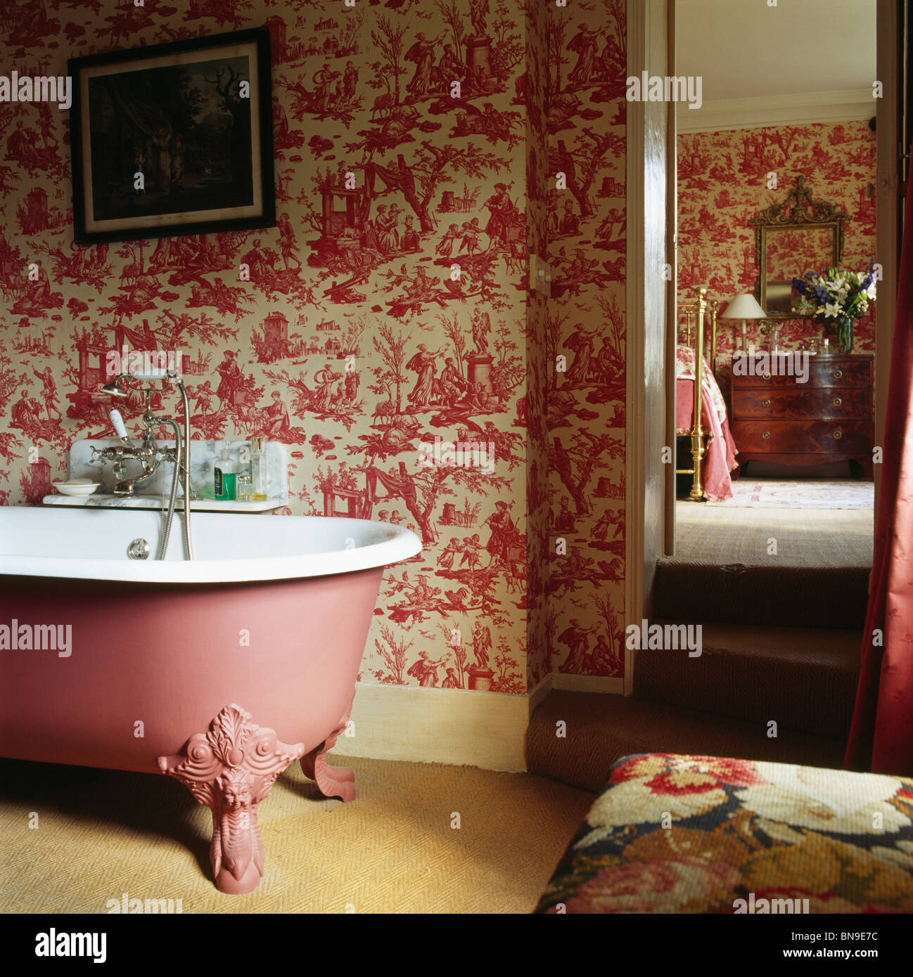 Pink Toile De Jouy Wallpaper And Pink Roll Top Bath In En Suite