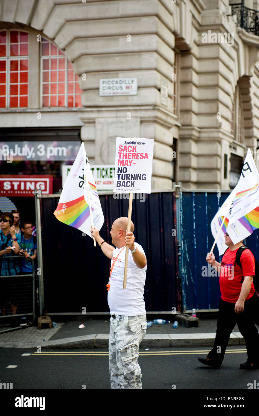 A participant holding a placard during the Pride London celebrations.  Photo by Gordon Scammell - Stock Image